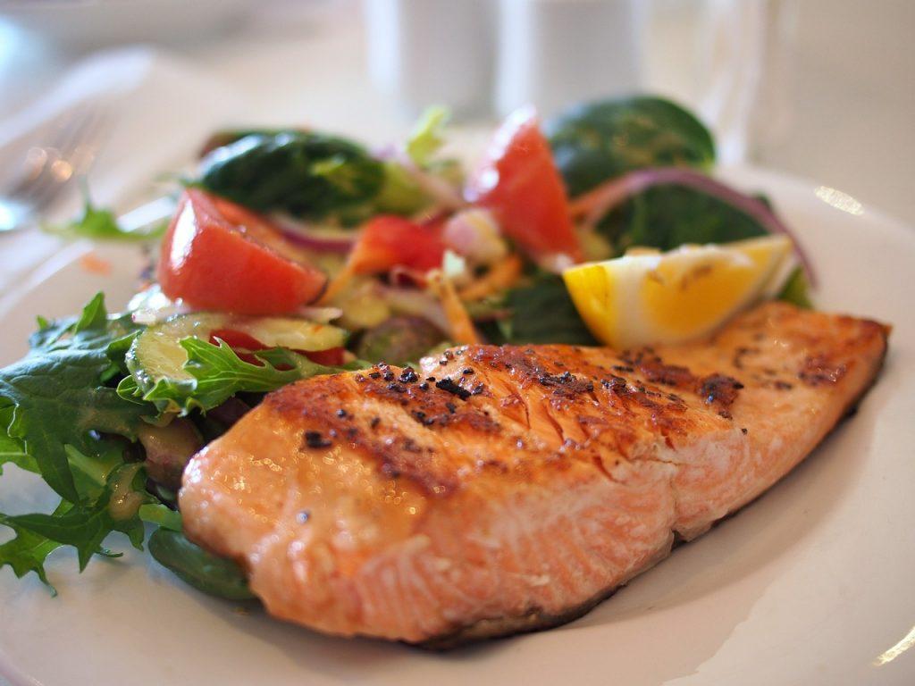 Autentic ethnic restaurants in New York City offer salmon Dominican style