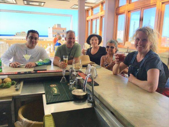 Five people at La Guarida visit on our cuba cultural tour
