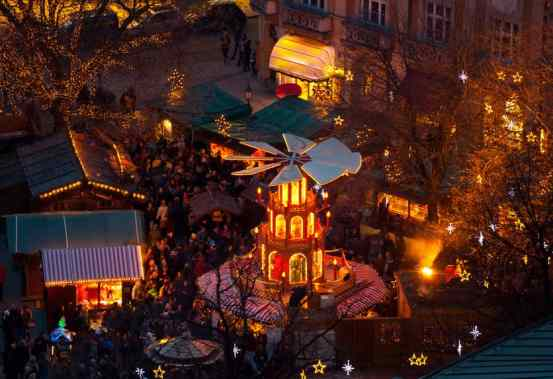 Typical wooden Christmas carousel, Munich, Bavaria, Germany, at a Christmas market.