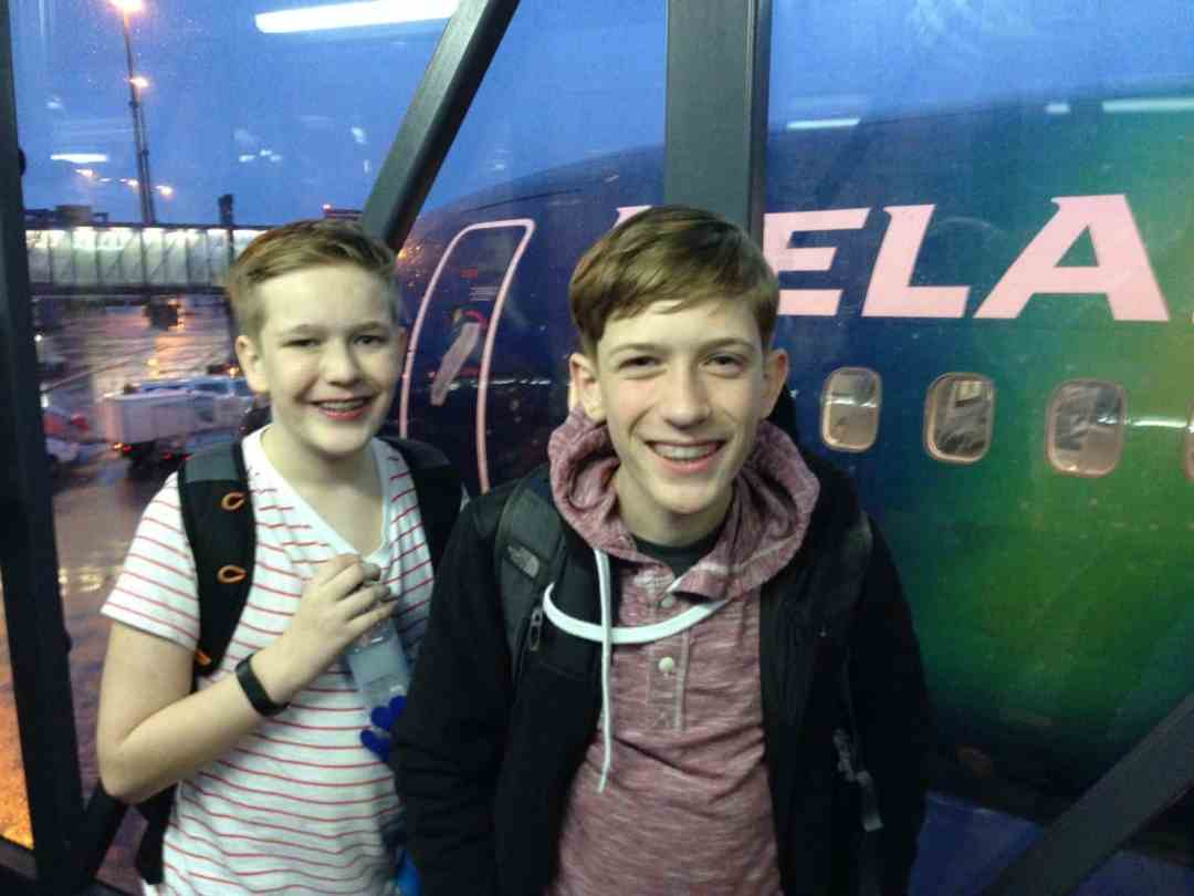 Kids waiting to board a plane