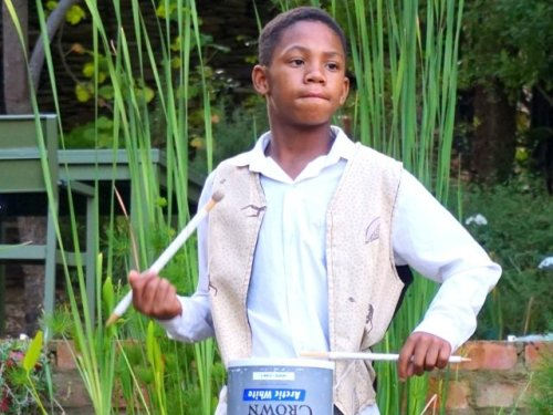 Boy drumming Barrydale South Africa