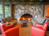 Glacier Bay lodge fireplace and sitting area