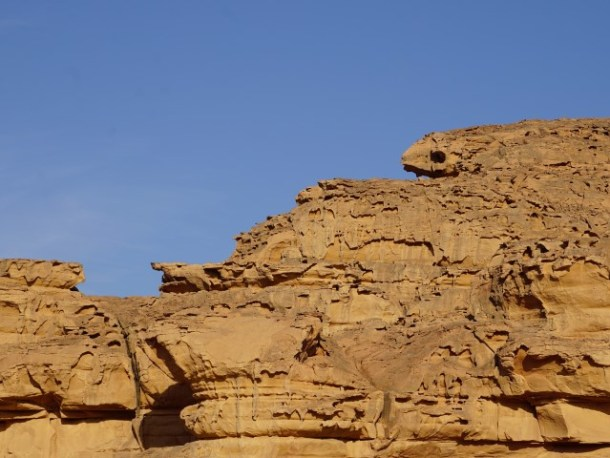 Weathered rock face in Wadi Rum which looks like melted wax