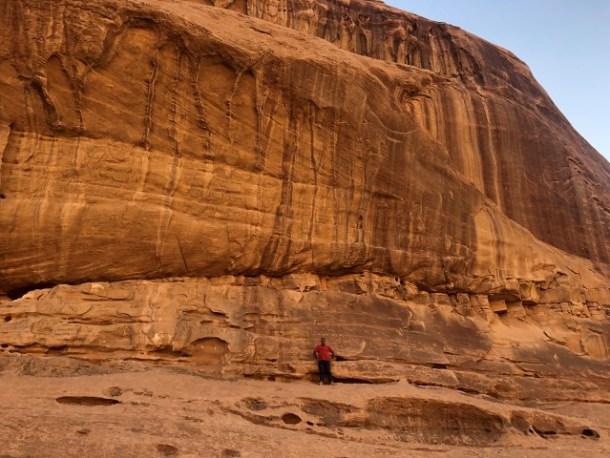 Viewing an Umm Ishrim sandstone cliff at Wadi Rum, Jordan