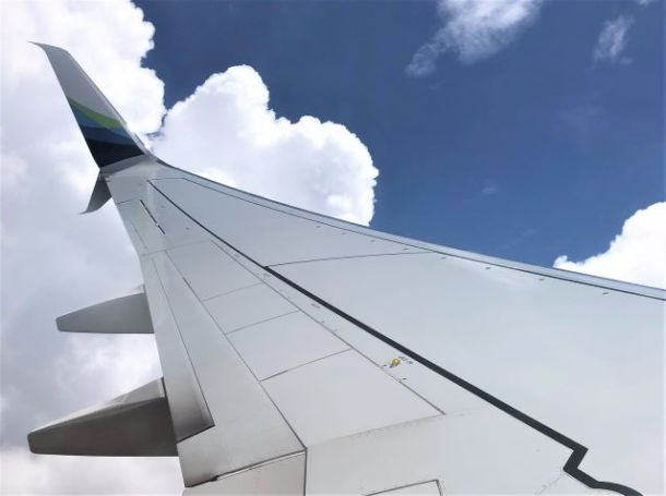 wing of airplane in clouds