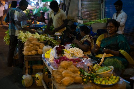 A stall holder sells temple offerings in Chennai.