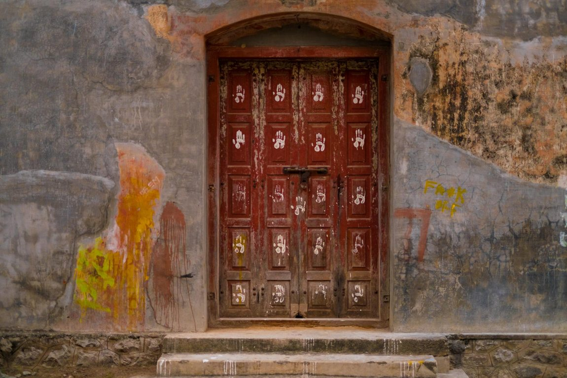 Doors painted with handprints in Kochi