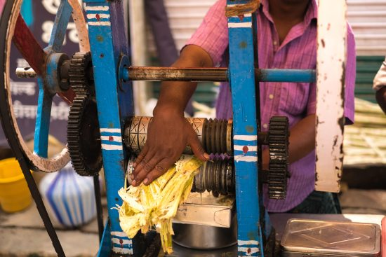 Sugarcane juice being squeezed in Madurai