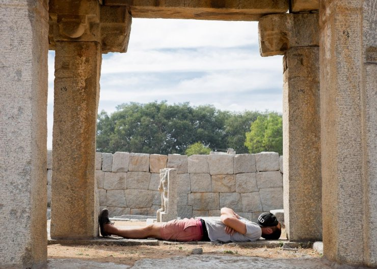 A day of cycling in the heat in Hampi requires breaks for naps in the ruins.