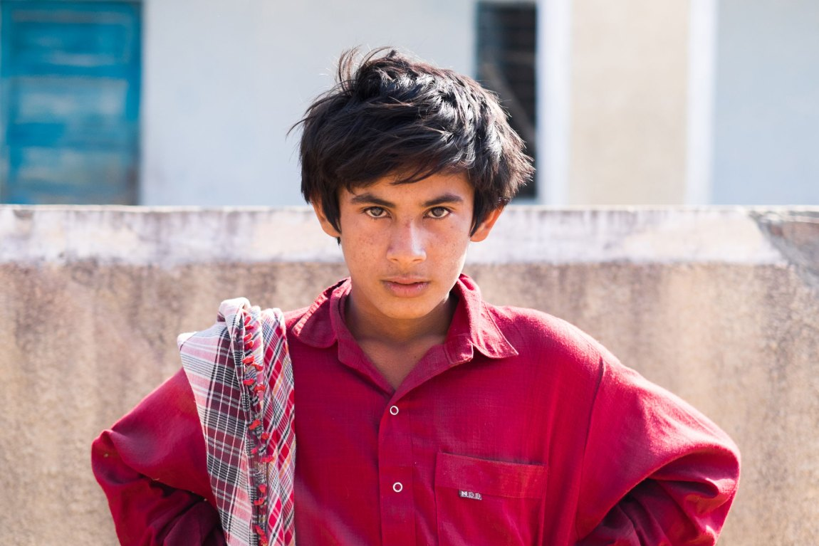 A teenage boy in the village who agreed to let me take a photo, stares intensely into the camera.