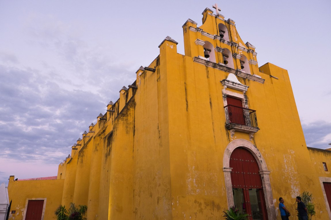 A yellow and red church
