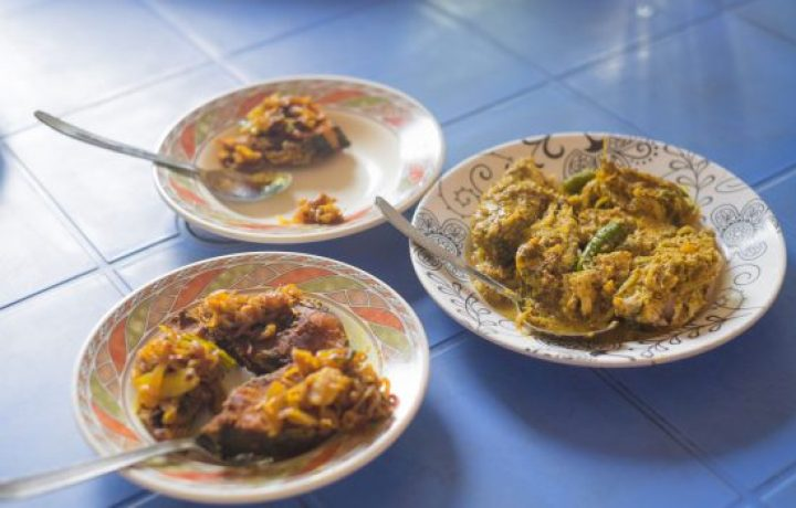 Fish bhuna as part of a New Year's Day meal in Bangladesh.