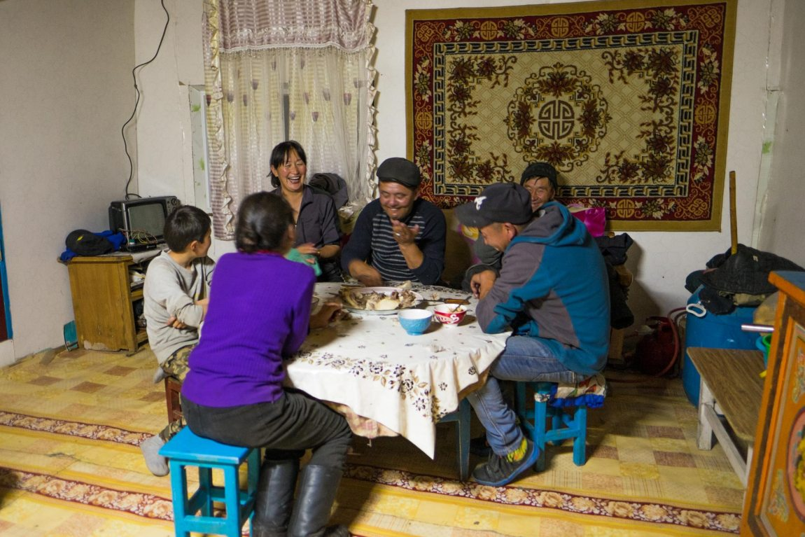 A family of yak farmers tucks into a platter of lamb fat.