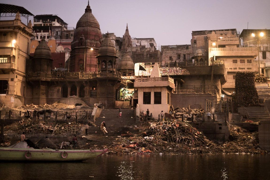 Piles of wood on the banks of the river Ganges where bodies are burned.