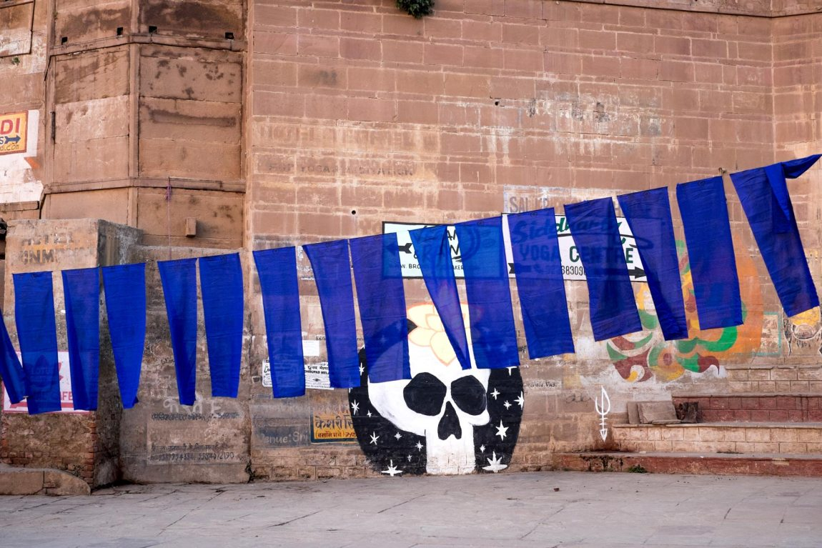 Blue material dries on the ghats in Varanasi