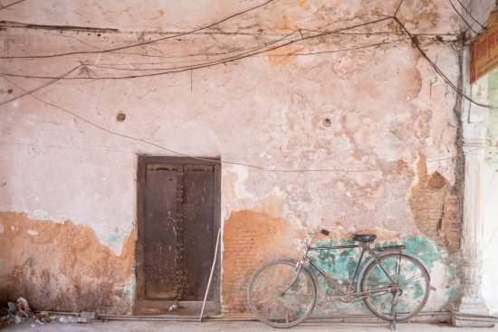 A bike rests against a wall in Varanasi