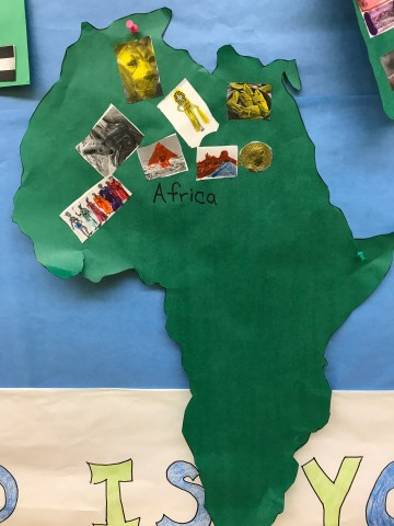 Students seven continent bulletin board travelteachlove my aide and i had traced and cut each continent onto bulletin board paper students then cut and glue their own pictures onto gumiabroncs Image collections