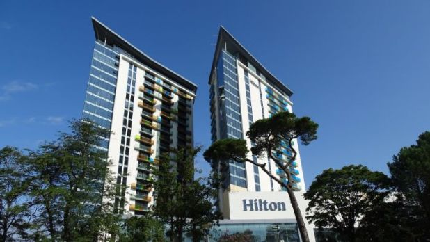 earn frequent flyer miles staying at the Hilton
