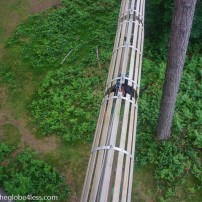 crawling through the suspended tunnel at Go Ape