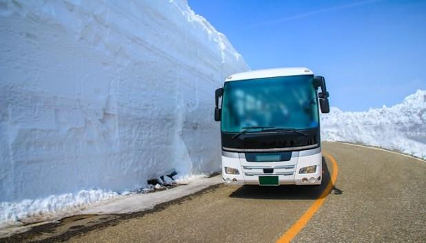 bus on snowy road in Japan
