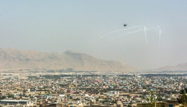 Helicopter shooting flares in Kabul