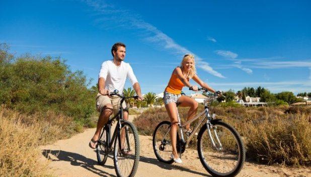 couple biking in portugal