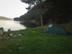 camping on the shore of Lake Dospat