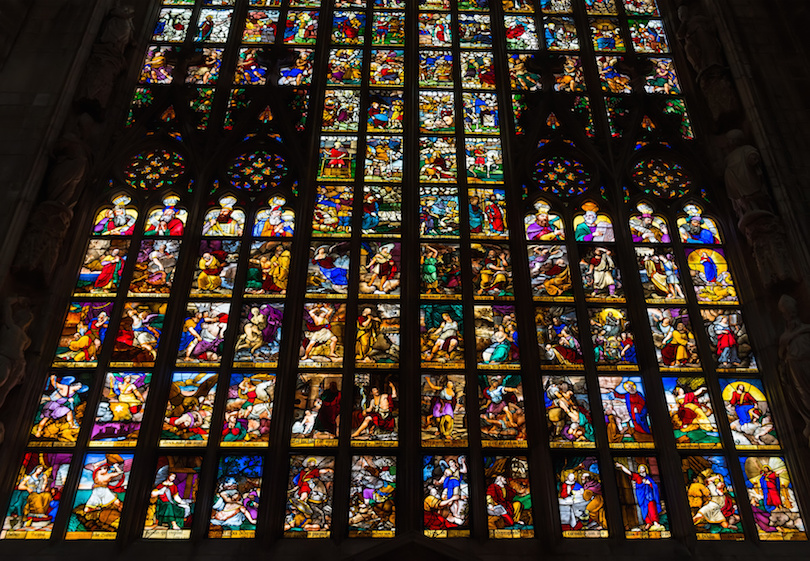 Colorful stained-glass windows in Duomo in Milan.