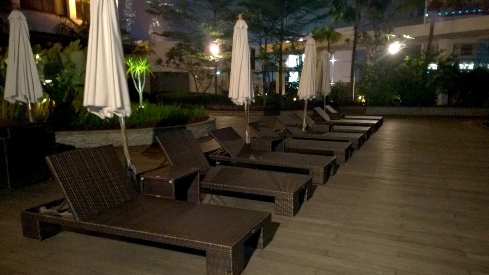 Loungers at the pool at night