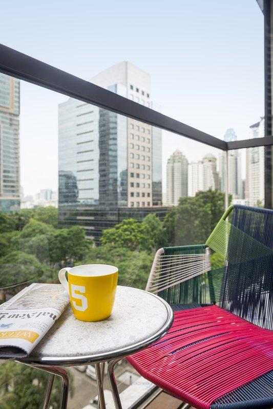 You may alternatively enjoy a coffee on your own balcony (Image Source: Hotel Indigo Bangkok / ihg.com)