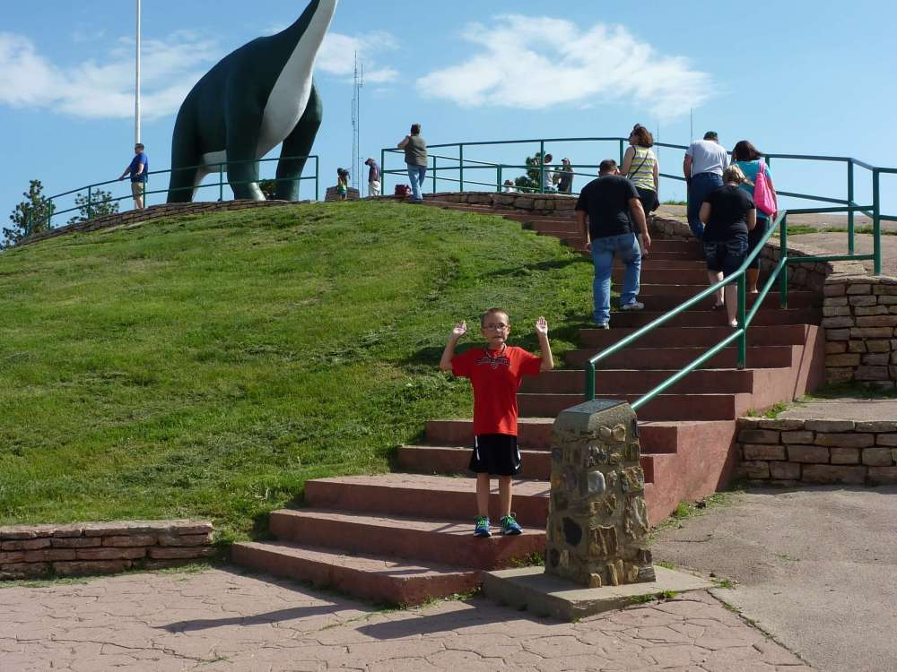 The Best Things to Do in the Black Hills with your Family featured by top US family travel blog, Travel with a Plan: image of dinosaur park