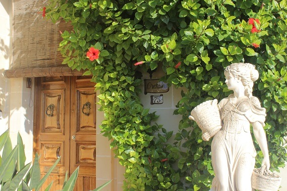 House in Luqa decorated with straw cover, door handles, flowers, ceramic decorations and s statue