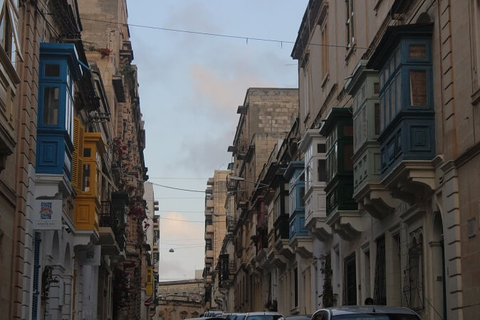 Street of Sliema with traditional maltese colorful balconies