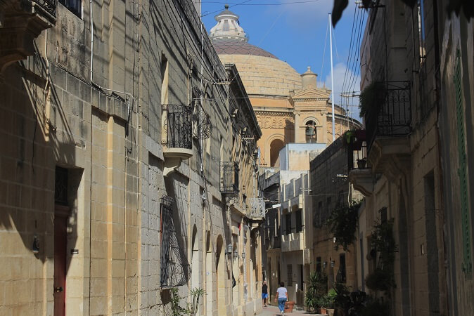 Honey colored houses and dome in Mosta