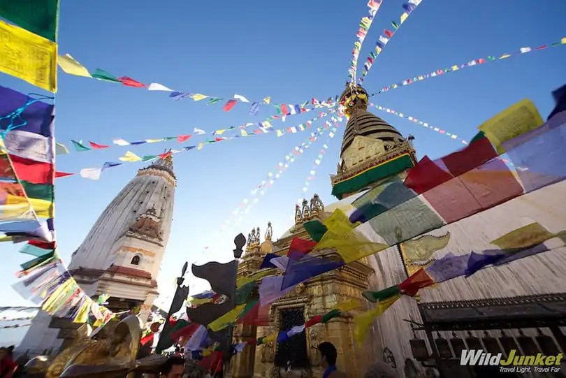 Colorful Tibetan flags fly high at the UNESCO site Swayambhunath Temple, that has destroyed by the earthquake.