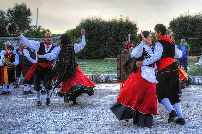 Traditional costumes of dancers at Grape Harvest Festival, Locorotondo, Puglia, Italy