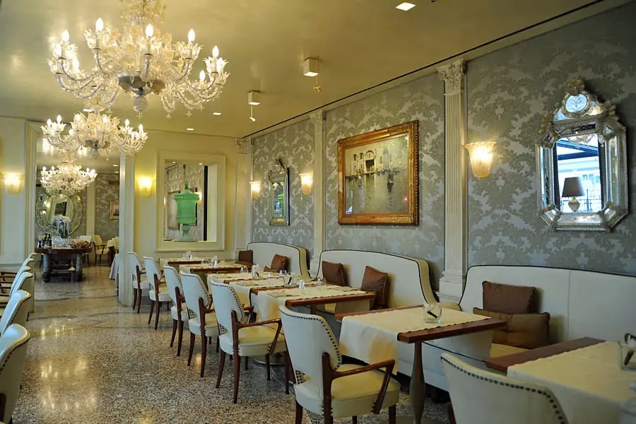 The elegant dining room with Murano glass in the Hotel Londra Palace, Venice, Italy