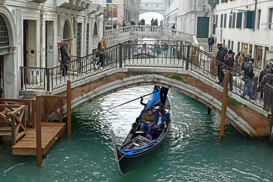 ONe of the many pretty bridges crossing the canals of Venice in Italy