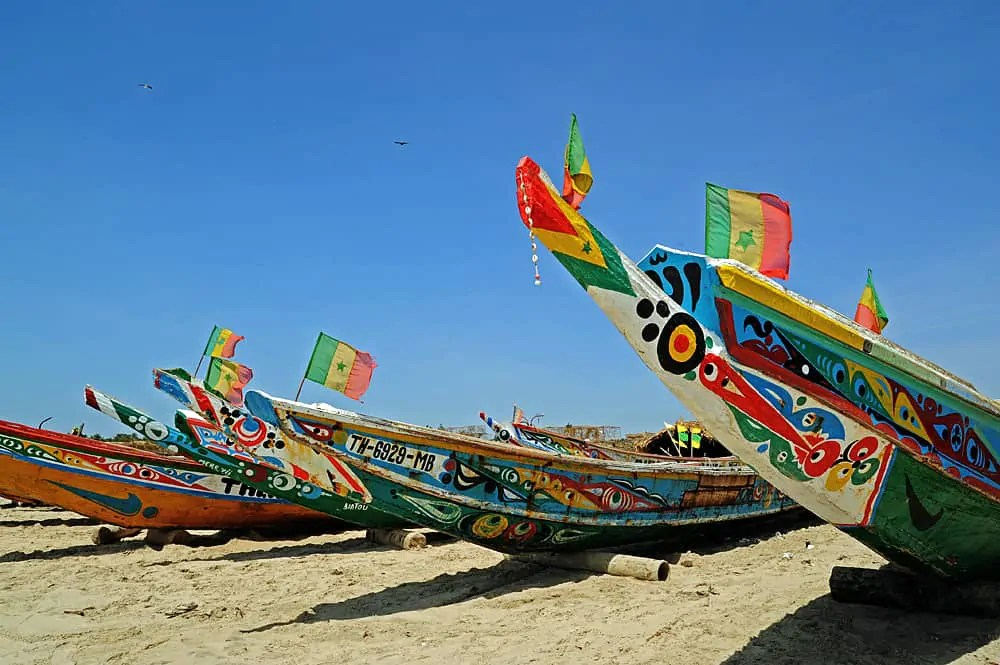 Colourful pirogues, the local fishing boats on a beach in The Gambia, West Africa