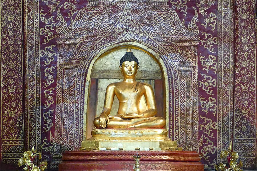 The highly revered Buddha, Phra Buddha Sihing housed in the Wihan Lau Kham in the Wat Phra Singh temple complex in Chaing Mai, Thailand