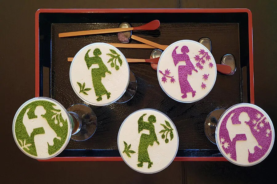 Overhead view of the matcha ice cream glasses showing the stencilled picture of a girl in a kimono dancing