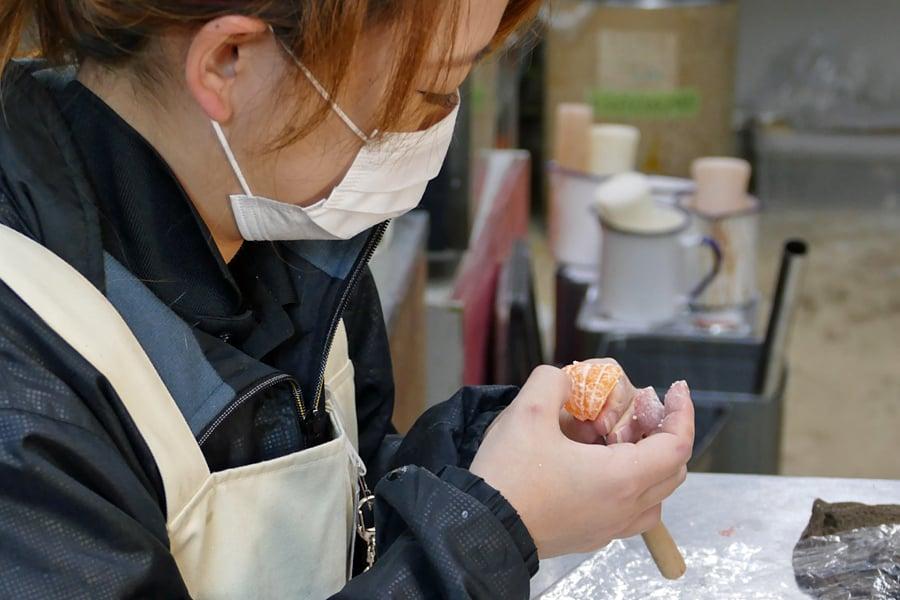 Lady holding the handmade fake mandarin segments