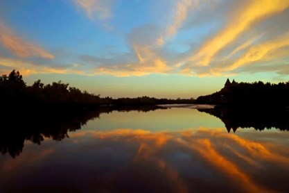 Sunset at Mandina Lodges, Makasutu Forest, The Gambia by travel photographer, Kathryn Burrington