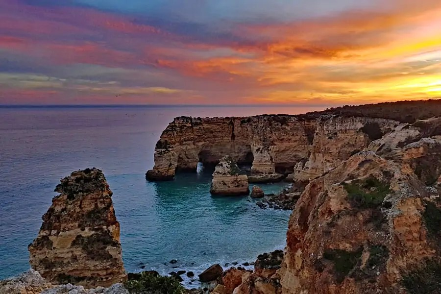 Praia do Marinha at sunset, a must see on your Algarve holiday