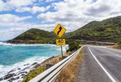 The yellow bend and 40 km h speed limit signs on the great ocean road in Victoria, Australia