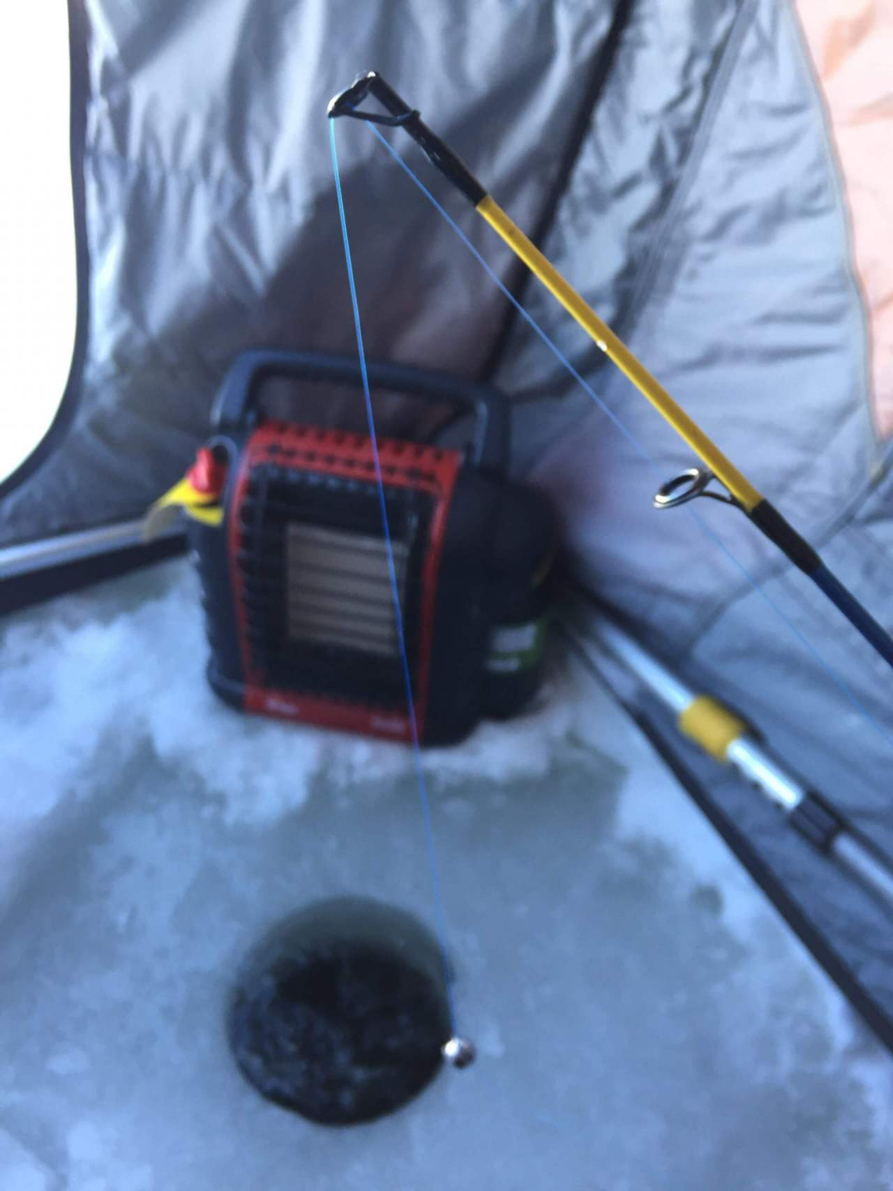 Windy Lake Ice Fishing Set Up with Electric Heater & Fishing Rod