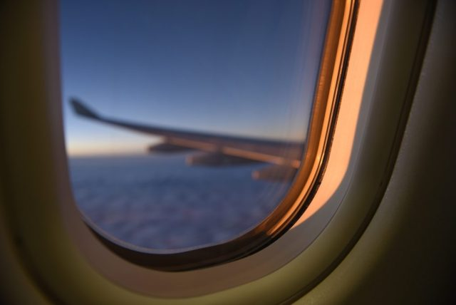 Aircraft wing as seen through window
