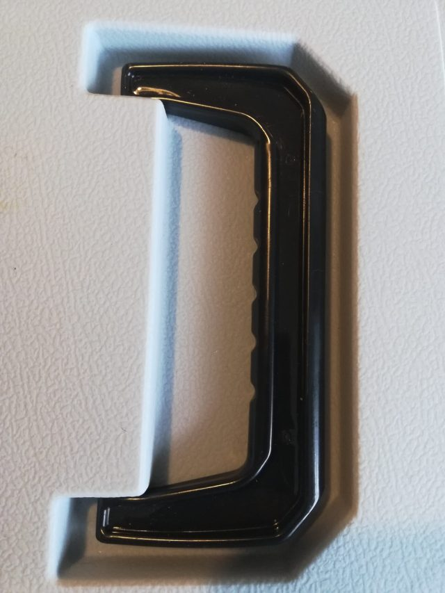 Close up of plastic cat carrier handle