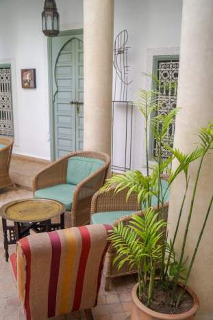 Riad Les Hibiscus courtyard seating area