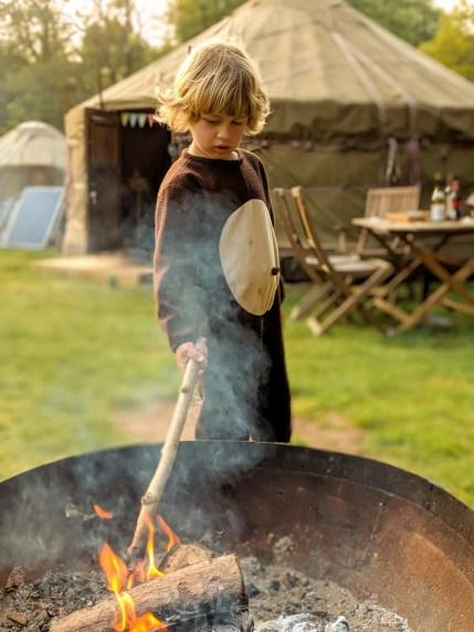 boy by firepit